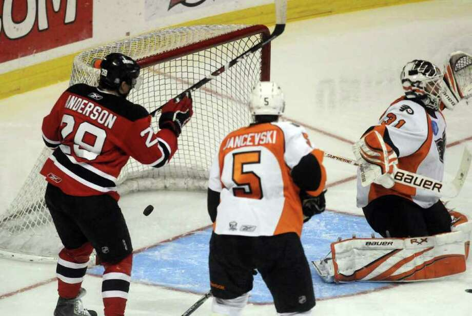A goal gets by Adirondack Phantoms goalie Johan Backlund during their game against the Albany Devils at the Times Union Center in Albany Tuesday March 29, 2011.( Michael P. Farrell/Times Union ) Photo: Michael P. Farrell