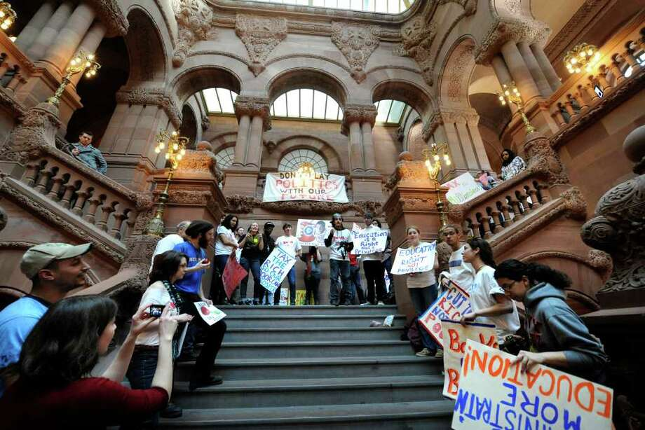 Student from SUNY colleges throughout the State of  New York gather to complain about the  pending budget cuts during a rally on the Million Dollar Staircase in the State Capitol in Albany, New York March 15, 2011. (Skip Dickstein / Times Union) Photo: Skip Dickstein / 2008