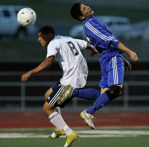 New Braunfels' Sergio Mendez (right) and Roosevelt's Erik Nino (08) go for a header in boys soccer at Comalander Stadium on Tuesday, March 29, 2011. Photo: Kin Man Hui/kmhui@express-news.net / San Antonio Express-News NFS