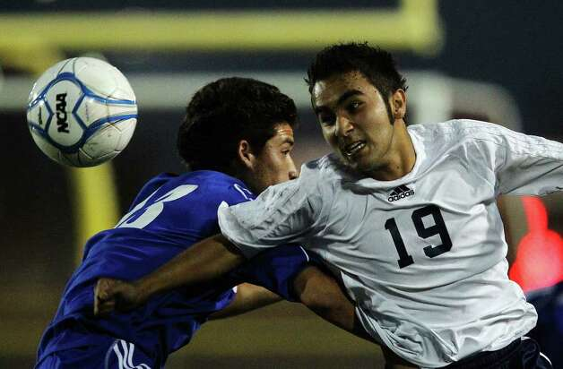 Roosevelt's Alan Garcia (19) passes a header against New Braunfels' Antonio Becerra (13) in boys soccer at Comalander Stadium on Tuesday, March 29, 2011. Photo: Kin Man Hui/kmhui@express-news.net / San Antonio Express-News NFS