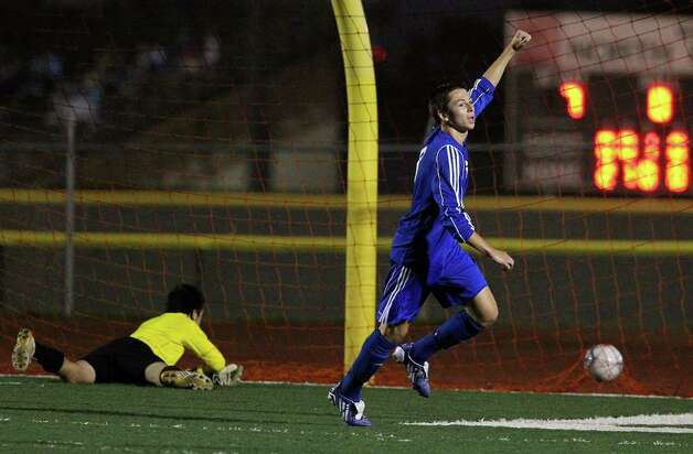 New Braunfels' John O'Brien (right) reacts after scoring a goal against Roosevelt's goalkeeper Vincent Barretto (left) in boys soccer at Comalander Stadium on Tuesday, March 29, 2011. Photo: Kin Man Hui/kmhui@express-news.net / San Antonio Express-News NFS