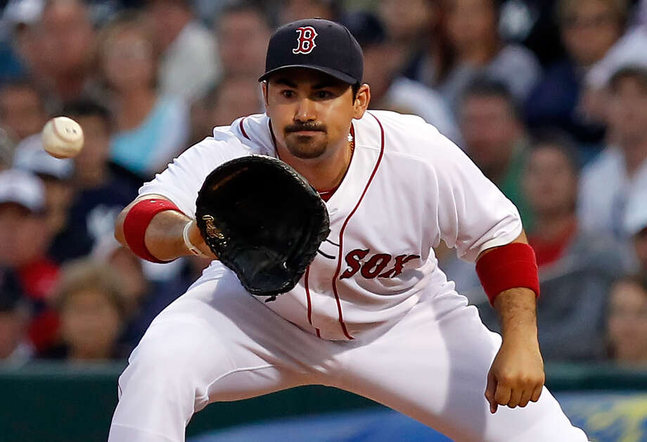 Adrian Gonzalez hasn't hit below .277 or had fewer than 24 home runs in five seasons in San Diego. The first baseman's stats should skyrocket in a talented lineup and a hitter's park in Boston. Photo: J. Meric/Getty Images / 2011 Getty Images