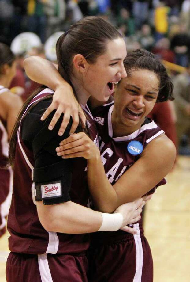 Texas A&M guard Sydney Carter, right, and Maryann Baker celebrate after Texas A&M defeated Baylor 58-46 in an NCAA women's college basketball tournament regional final, Tuesday, March 29, 2011, in Dallas. Photo: LM Otero/Associated Press