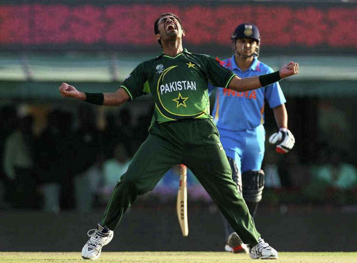 MOHALI, INDIA - MARCH 30: Wahab Riaz of Pakistan celebrates after taking the wicket of MS Dhoni of India during the 2011 ICC World Cup second Semi-Final between Pakistan and India at Punjab Cricket Association (PCA) Stadium on March 30, 2011 in Mohali, India. (Photo by Hamish Blair/Getty Images) *** Local Caption *** Wahab Riaz