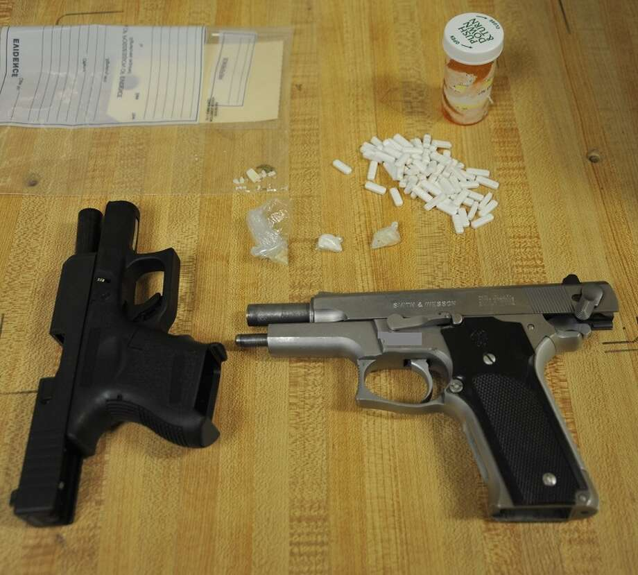Drugs and firearms were seized by officers during the execution of a narcotics search warrant in Orange on March 29. Someone is accused of shooting at officers during the execution. Photo courtesy of the Orange Police Department