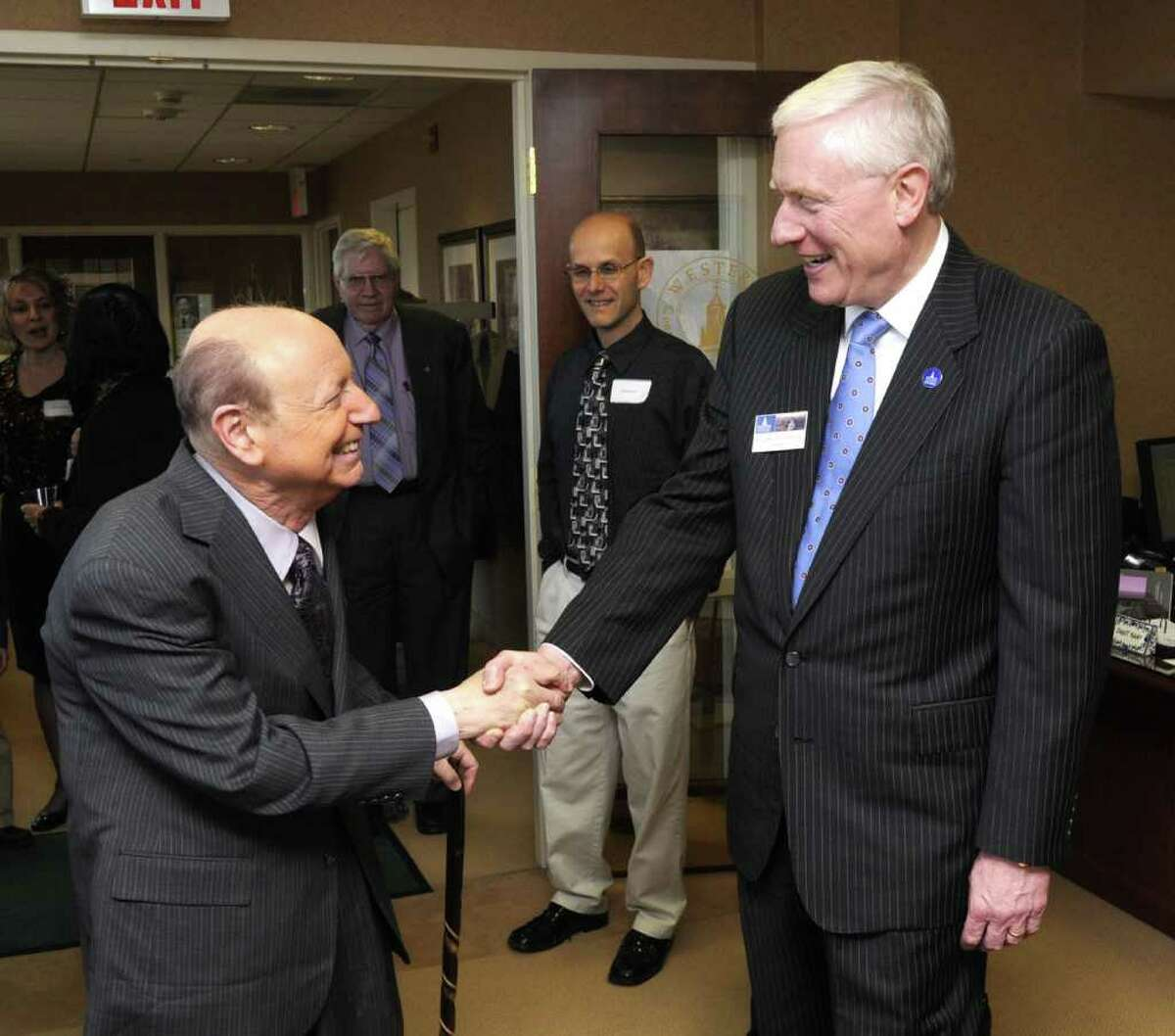 Dr. Mel Goldstein, meteorologist and author, is greeted by Western Connecticut State University President James Schmotter at a reception, before giving the Presidents Lecture,