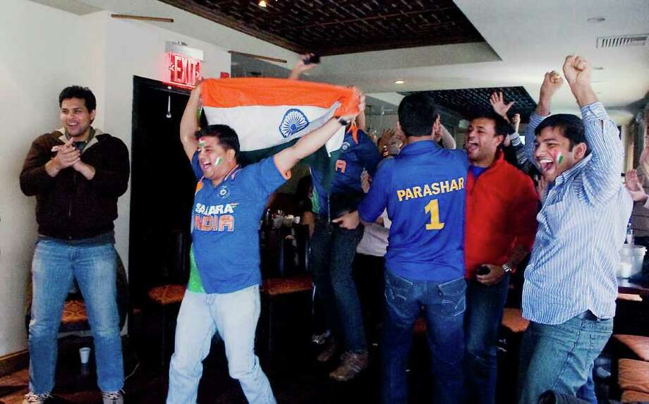 Local cricket fans cheer on team India as they gather at Tawa Indian Restaurant to watch a telecast of the World Cup match between India and Pakistan in Stamford, Conn. on Wednesday March 30, 2011. Photo: Kathleen O'Rourke / Stamford Advocate