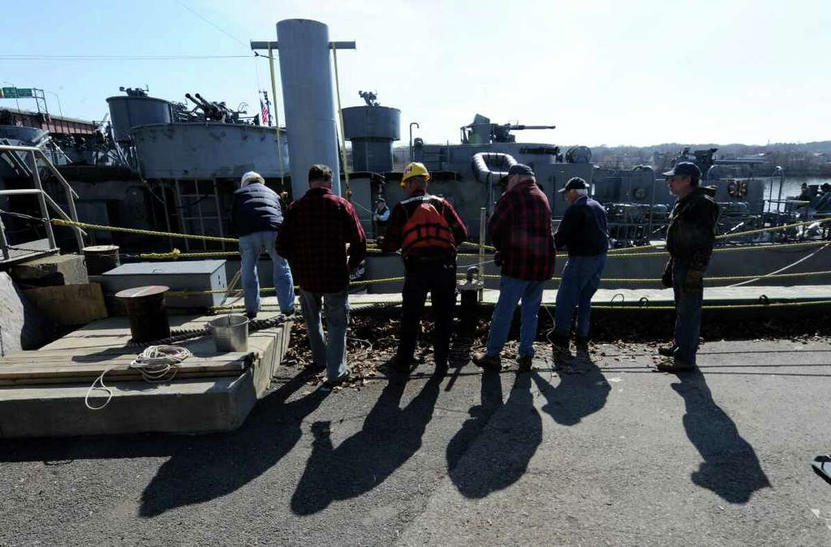 Another sign of spring: the USS Slater moves to the Albany side of the port from its winter dock on the Rensselaer side of the Hudson River on March 30, 2011. Volunteer deckhands pull in the ropes to secure the ship. (Skip Dickstein / Times Union)