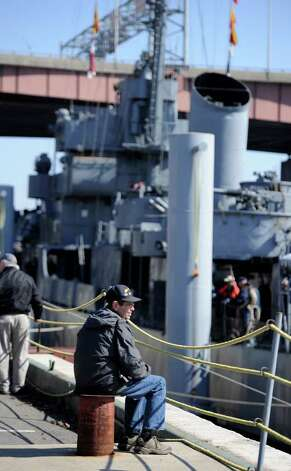 Volunteer Jim Gelston takes a breather as he watches the USS Slater  move from its winter dock on the Rensselaer side of the Hudson River to the Albany, New York, side of the river on March 30, 2011.  (Skip Dickstein / Times Union) Photo: SKIP DICKSTEIN / 2008