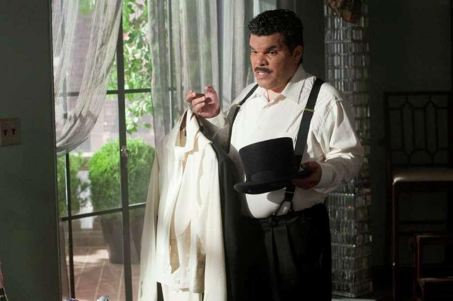 "ARTD-06675 LUIS GUZMÁN as Bitterman in Warner Bros. Pictures' romantic comedy ""ARTHUR,"" a Warner Bros. Pictures release. Photo: Barry Wetcher / ©2011 Warner Bros. Entertainment Inc."