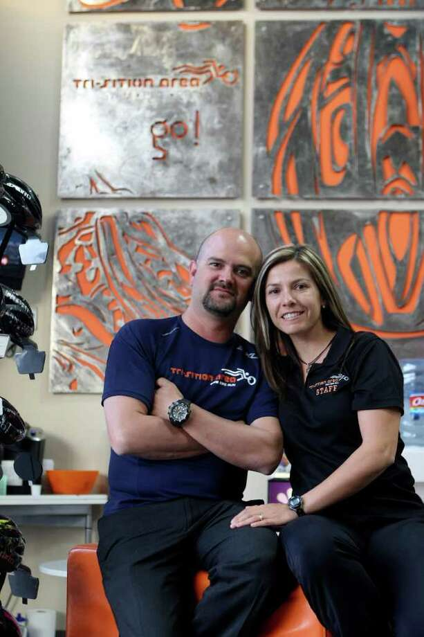 CONEXION: Marco and Lorena Garsed are the owners of Tri-Sitions Area, a shop for triathletes.  HELEN L. MONTOYA/hmontoya@express-news.net Photo: HELEN L. MONTOYA, SAN ANTONIO EXPRESS-NEWS / SAN ANTONIO EXPRESS-NEWS