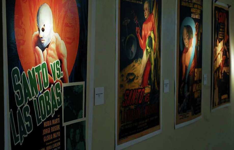 A poster of famous Mexican wrestler El Santo are show in the Border Heritage Museum during an exhibition. 'El Santo vs Las Mujeres Vampiro' will be screened on October 4 as part of the 'Movies on the Patio' series.  Photo: Ulysses S. Romero / Laredo Morning Times