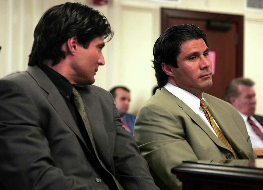 Ozzie Canseco, left, looks at his brother Jose Canseco , right, as plaintiffs witness Lawrence C. Epstein, a Certified Public Accountant of Berger, Epstein & Garber, gives testimony about Jose's finances during a punitive damages hearing, Tuesday, April 26, 2005, in a Miami-Dade County courtroom. Canseco and his twin brother Ozzie were found liable Monday in a lawsuit by two men whom they beat up at a Miami Beach nightclub on Halloween 2001. Plaintiffs Christian Presley and Alan Cheeks were awarded the more than $700,000 in compensatory damages. Photo: LUIS M. ALVAREZ, AP / AP