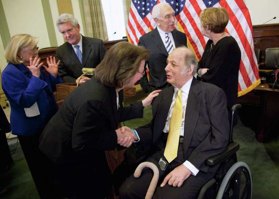 Robyn Ringler of Ballston Lake shakes hands with former White House press secretary James Brady at a news conference  Wednesday marking the 30th anniversary of the assassination attempt on President Ronald Reagan. Brady was left paralyzed in the shooting;  Ringler was a nurse  assigned to care for Reagan. Also at the news conference on Capitol Hill in Washington are Rep. Carolyn McCarthy, D-N.Y., left; Paul Helmke, president of the Brady Campaign; Sen. Frank Lautenberg, D-N.J.; and Brady's wife, Sarah.  (Evan Vucci / Associated Press) Photo: Evan Vucci