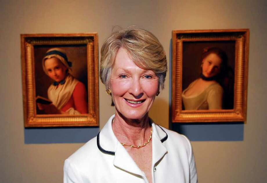 """Marei von Saher of Greenwich poses next to two paintings from her late father-in-law Jacques Goudstikker's collection at the Bruce Museum in this May 2008 file photo. Both paintings, among possibly thousands of others, were looted by the Nazis from Goustikker's collection in Amsterdam during World War II. The painting at left is by artist Pietro Antonio Rotari, titled, """"The Virtuous Girl,"""" the painting at right is by the same artist and titled, """"The Frivolous Girl."""" Von Saher wants a Pasadena museum to return two 500-year-old paintings also part of the seized collection. Photo: File Photo, ST / Greenwich Time File Photo"""