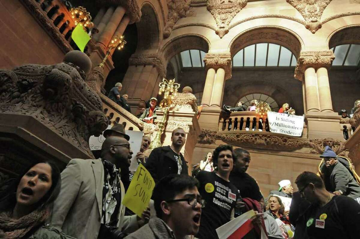 Students and activists protest cuts to to SUNY in the New York State budget on the Million Dollar Staircase at the Capitol in Albany Wednesday March 30, 2011.( Michael P. Farrell/Times Union )