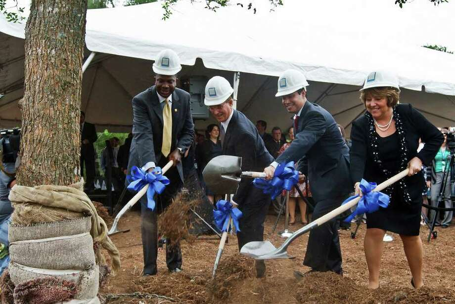 Nationwide celebratedits new facility in Westover Hills with a groundbreaking and tree planting ceremony Tuesday. (From left) Regional Vice president Terrance Williams, County Judge Nelson Wolff, San Antonio Mayor julian Castro and Michelle Premo-Koehler, vice president of the new customer service center, turn the first dirt. Photo: Marvin Pfeiffer/Prime Time Newspapers