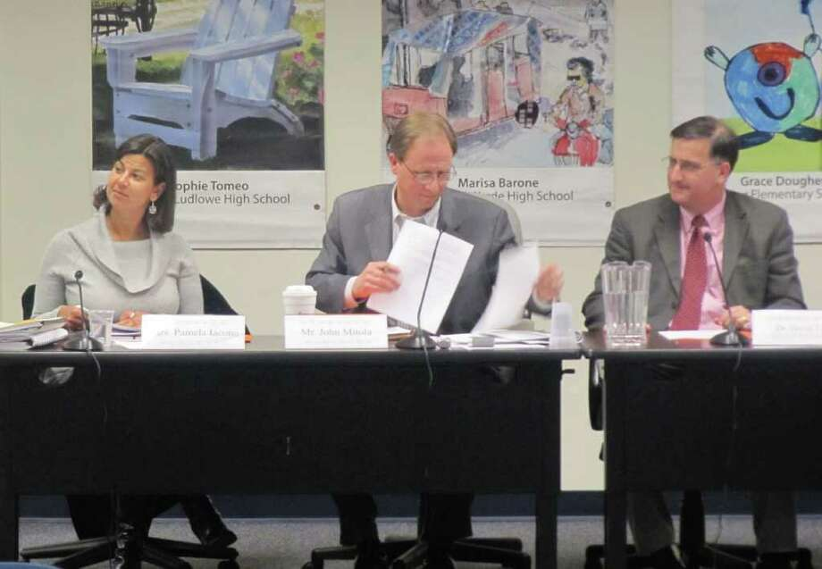 Pictured from left to right, at Tuesday's Board of Education (BOE) meeting, are BOE Vice-Chairman Pamela Iacono, Chairman John Mitola and Superintendent of Schools David Title. The Long Range Facilities Plan was one of the main agenda items. In this photo, Iacono, Mitola and Tittle smile while listening to a board member's comments. Photo: Kirk Lang / Fairfield Citizen