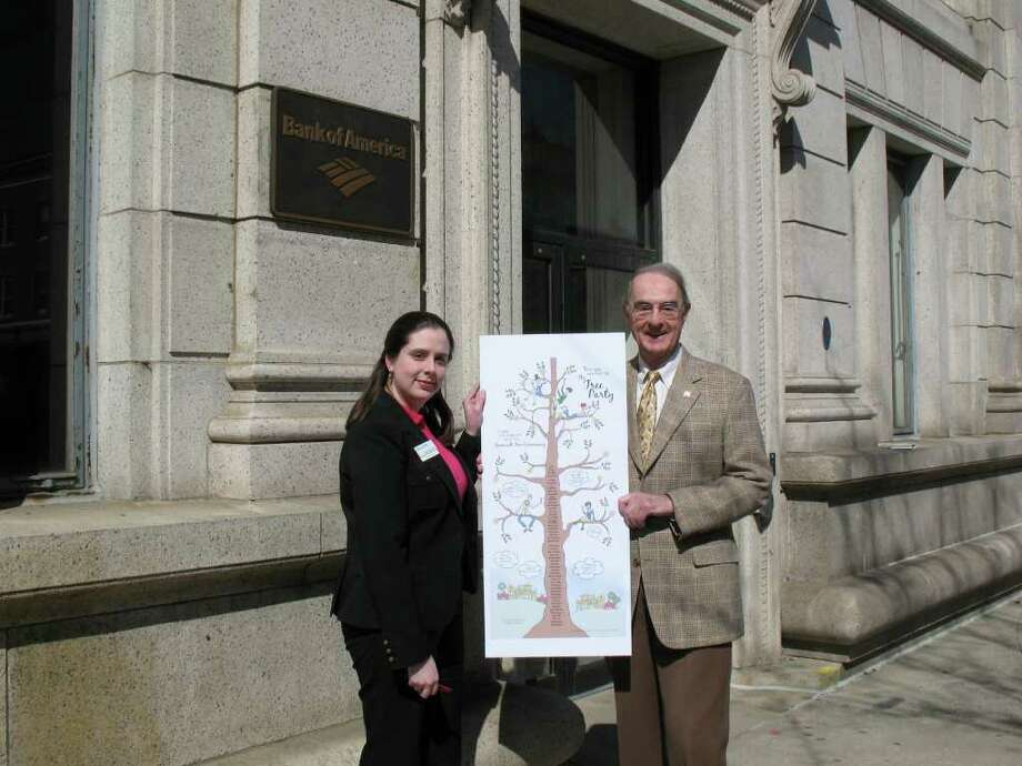 """Roberta Rich, vice-president of the Greenwich branch of Bank of America, and Peter Malkin, president of the Greenwich Tree Conservancy, are pictured holding a copy of the invitation to Friday's """"Tree Party"""" fundraising event. The party is the Greenwich Tree Conservancy's first fundraising event. Photo: Contributed Photo / Greenwich Time Contributed"""