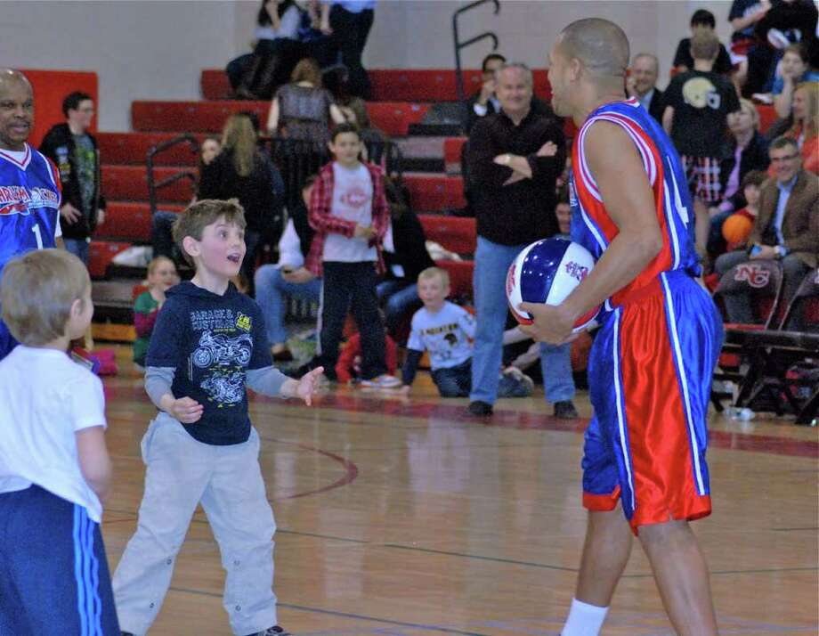 """Harlem Rocket""""Speedy"""" Williams gets the kids involved at halftime with a game of """"You are OUT!"""" Colin Ratner gives him his money's worth and hangs in there longer than anyone else! Photo: Jeanna Petersen Shepard / New Canaan News"""