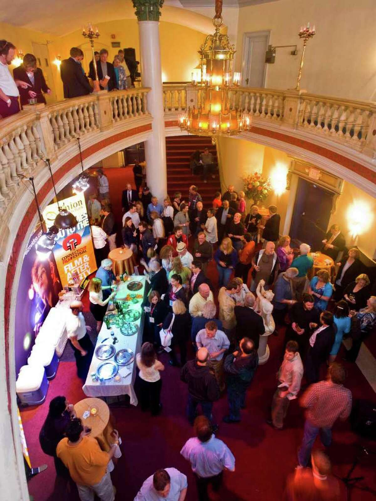 Folks gather in the lobby of the Palace Theater in Danbury prior to the start of the Connecticut Film Festival's showing of the documentary