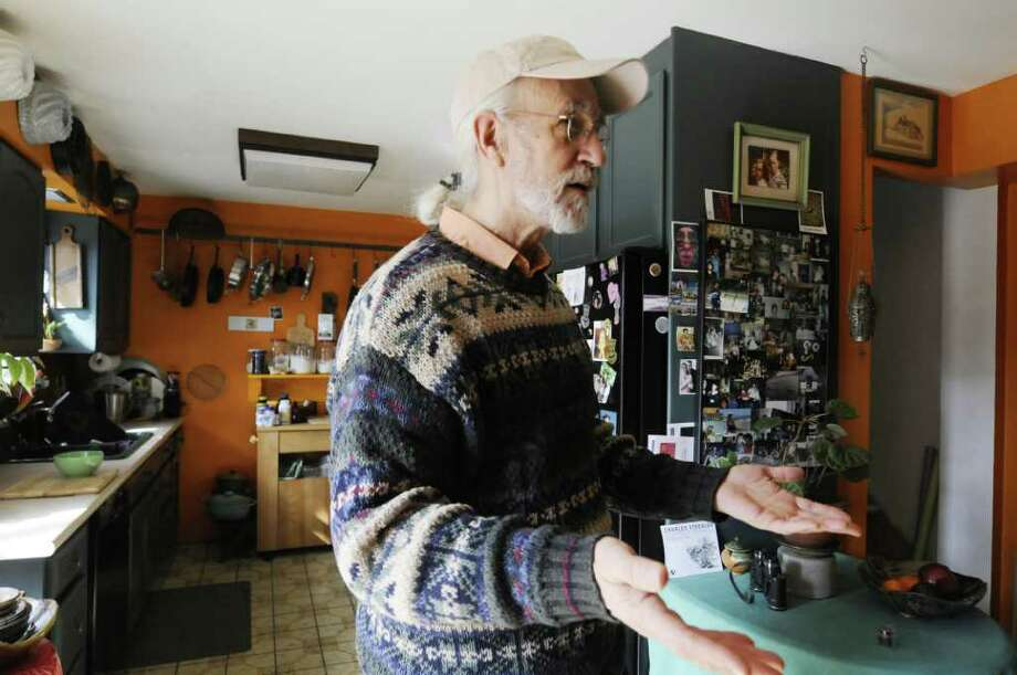 Ed Atkeson talks about one of his bank accounts that was drained by fees without his permission or knowledge at his home in Guilderland Tuesday March 29, 2011.( Michael P. Farrell/Times Union ) Photo: Michael P. Farrell
