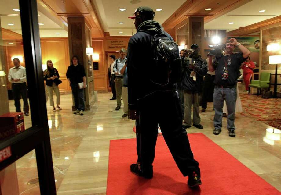 Connecticut Huskies forward/center Alex Oriakhi walks into the lobby of the JW Marriott in the Galleria, as he and the players of UConn arrive at their hotel, Wednesday, March 30, 2011, in Houston.  ( Karen Warren / Houston Chronicle ) Photo: Karen Warren, Houston Chronicle / Houston Chronicle