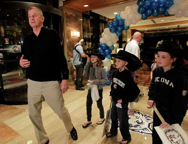 Connecticut Huskies head coach Jim Calhoun walks into the lobby of the JW Marriott in the Galleria, surrounded by his grandchildren, as he and the players of UConn arrive at their hotel, Wednesday, March 30, 2011, in Houston.  ( Karen Warren / Houston Chronicle ) Photo: Karen Warren, Houston Chronicle / Houston Chronicle