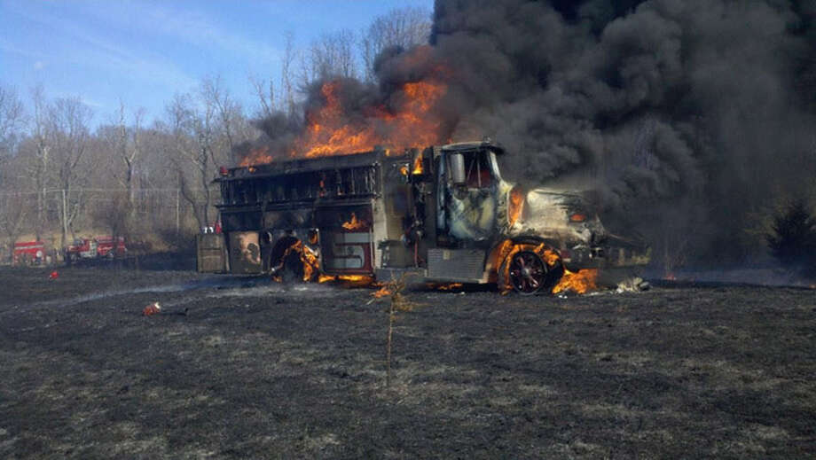 The Kent Fire Department lost this fire truck when the wind changed direction and sent a brush fire towards the truck (photo sent in by Ed Matson using our Report It feature), March 30, 2011. Photo: Contributed Photo / The News-Times Contributed