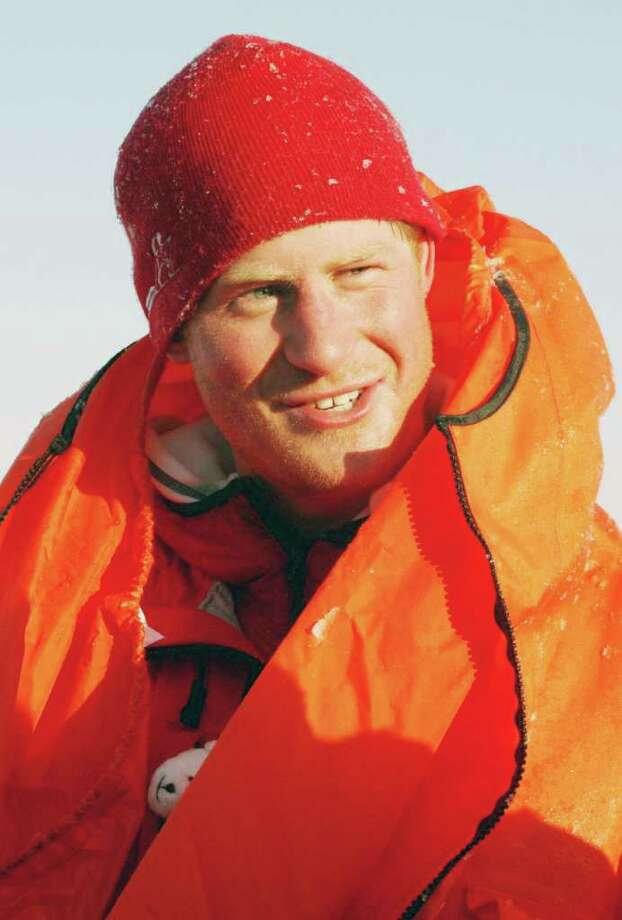 SPITSBERGEN, NORWAY - MARCH 30:  Britain's Prince Harry, joining the Walking with the Wounded expedition team, tries out an immersion suit on the island of Spitsbergen, situated between the Norwegian mainland and the North Pole, during the last days of preparation before setting off to the North Pole on foot, on March 30, 2011 in Spitsbergen, Norway.  (Photo by David Cheskin/WPA Pool/Getty Images) *** Local Caption *** Prince Harry Photo: WPA Pool, Getty Images / 2011 Getty Images