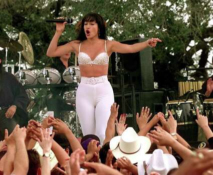Jennifer Lopez playing Selena performs during the filming of the Monterray concert scene in Poteet today. Area residents were used as extras for the crowd at the concert.  FOR METRO THELMA 10-19-96 Photo: DOUG SEHRES