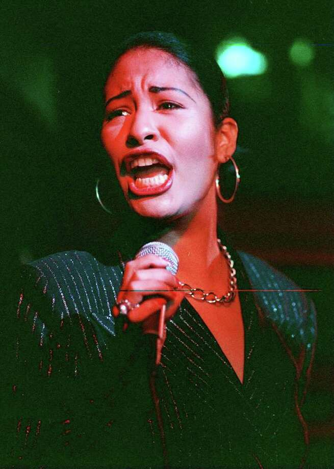 Tejano music star Selena performs at the grand opening of the San Antonio Hard Rock Cafe in this Jan. 25, 1995, file photo. Selena was killed Friday in Corpus Christi, TX. Photo by Rick Hunter Photo: Rick Hunter, SAN ANTONIO EXPRESS-NEWS / SAN ANTONIO EXPRESS-NEWS