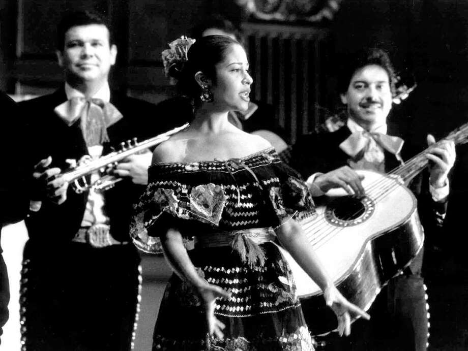 "Grammy-winning recording star Selena, who was fatally shot Friday in Corpus Christi, Texas, is seen performing in a scene from New Line Cinema's most recent release ""Don Juan DeMarco,"" which opens nationwide April 7, 1995. She appears in a cameo role. Photo: MERRICK MORTON, AP / NEW LINE CINEMA"