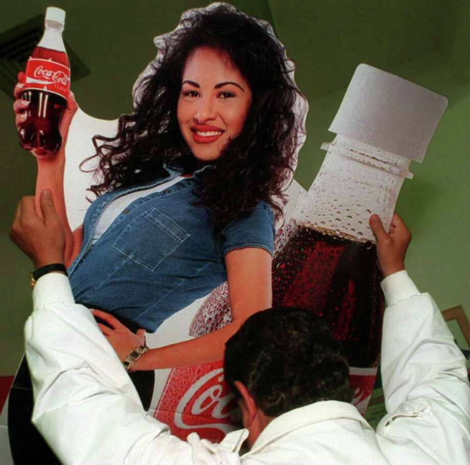 Rudy Trevino pulls out a poster of Selena that was used for advertising. E-N Photo Rudy Ornelas/ City Desk/ 95-1117/ #2