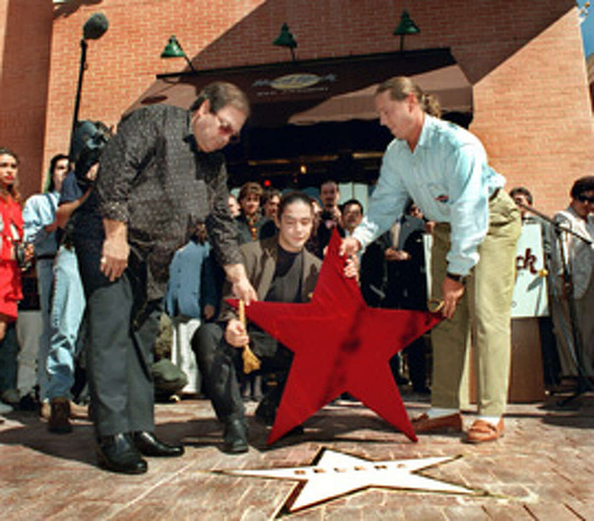 Check out her sidewalk star at Hard Rock Cafe Long before Selena's star was included on the Hollywood Walk of Fame, the Hard Rock Cafe in downtown San Antonio designated a spot outside the restaurant to honor her months after her 1995 death. Inside, fans can find Selena memorabilia, like an outfit worn by Queen of Tejano when she performed at the restaurant's grand opening in January 1995.