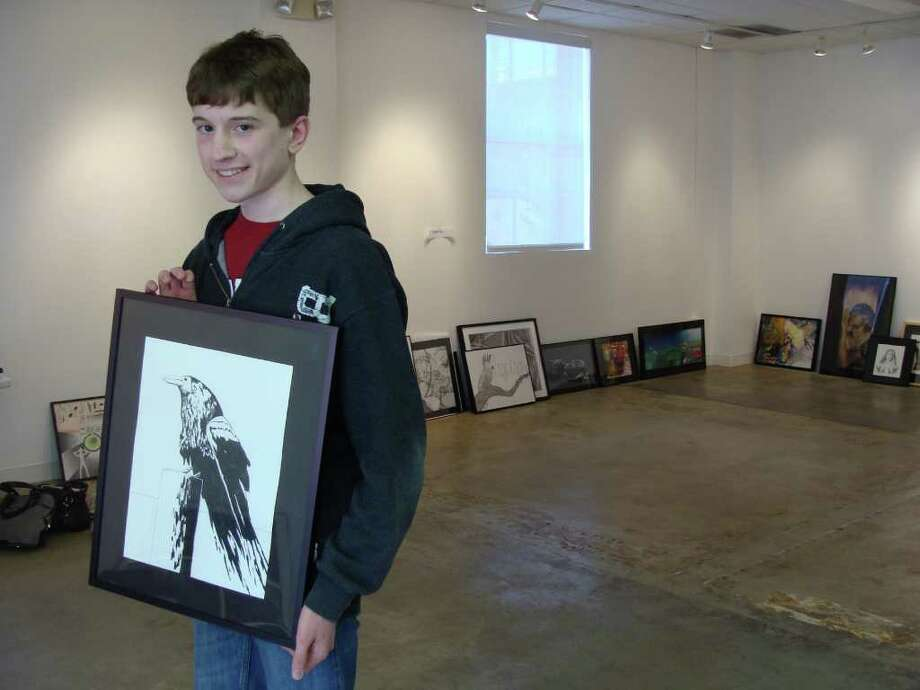 Matthew Crocker, 16, of Weston, holds a graphite drawing of his that will be exhibited in the Fairfield Arts Center's teen art show. The show opens Sunday and runs through April 16 at the Sanford Street gallery, and features work by young artists from around the region. Photo: Meg Barone / Fairfield Citizen freelance