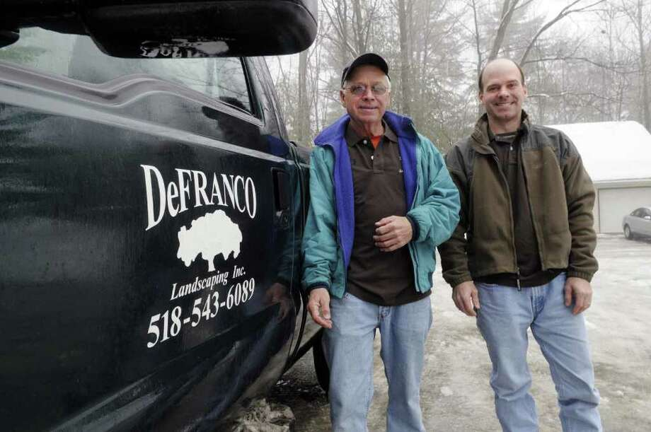 David DeFranco, left, and his son, Tony DeFranco, right, pose outside their business in Hague, NY on Monday, Feb. 28, 2011.  The business was honored last year by the Lake George Watershed Coalition for its work on using native plants and landscaping techniques to protect the water quality of the lake. Lake water quality has been declining in recent years as increasing development has increased the amounts of fertilizers, pesticides and other runoff that get into the lake.   (Paul Buckowski / Times Union) Photo: Paul Buckowski  / 10012100A