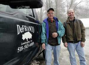 David DeFranco, left, and his son, Tony DeFranco, right, pose outside their business in Hague, NY on Monday, Feb. 28, 2011.  The business was honored last year by the Lake George Watershed Coalition for its work on using native plants and landscaping techniques to protect the water quality of the lake. Lake water quality has been declining in recent years as increasing development has increased the amounts of fertilizers, pesticides and other runoff that get into the lake.   (Paul Buckowski / Times Union)