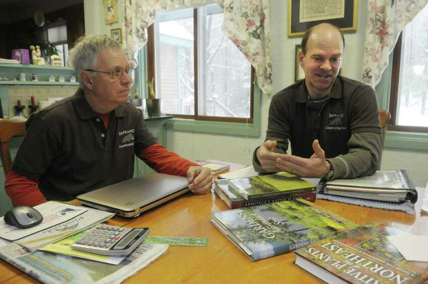 David DeFranco, left, and his son, Tony DeFranco, right, talk about their landscaping business during an interview at the business in Hague, NY on Monday, Feb. 28, 2011. The business was honored last year by the Lake George Watershed Coalition for its work on using native plants and landscaping techniques to protect the water quality of the lake. Lake water quality has been declining in recent years as increasing development has increased the amounts of fertilizers, pesticides and other runoff that get into the lake. (Paul Buckowski / Times Union)