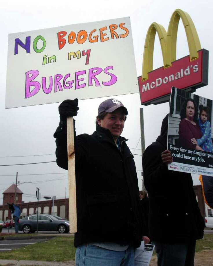 Kyle Anderson takes part in a prostest in front of the McDonald's restaurant on Fairfield Ave. in Bridgeport, Conn. March 31st, 2011. Photo: Ned Gerard / Connecticut Post