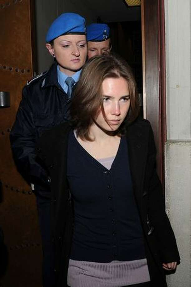 Amanda Knox attends her appeal hearing to reconsider her guilty verdict in the murder of Meredith Kercher, on Saturday, March 12, 2011 in Perugia, Italy. Knox's original trial took place in December 2009 when she was given 26 years while her former boyfriend Italian Raffaele Sollecito was given 25 years after they were both found guilty of the murder of Kercher in November 2007. Photo: Getty Images / Getty Images