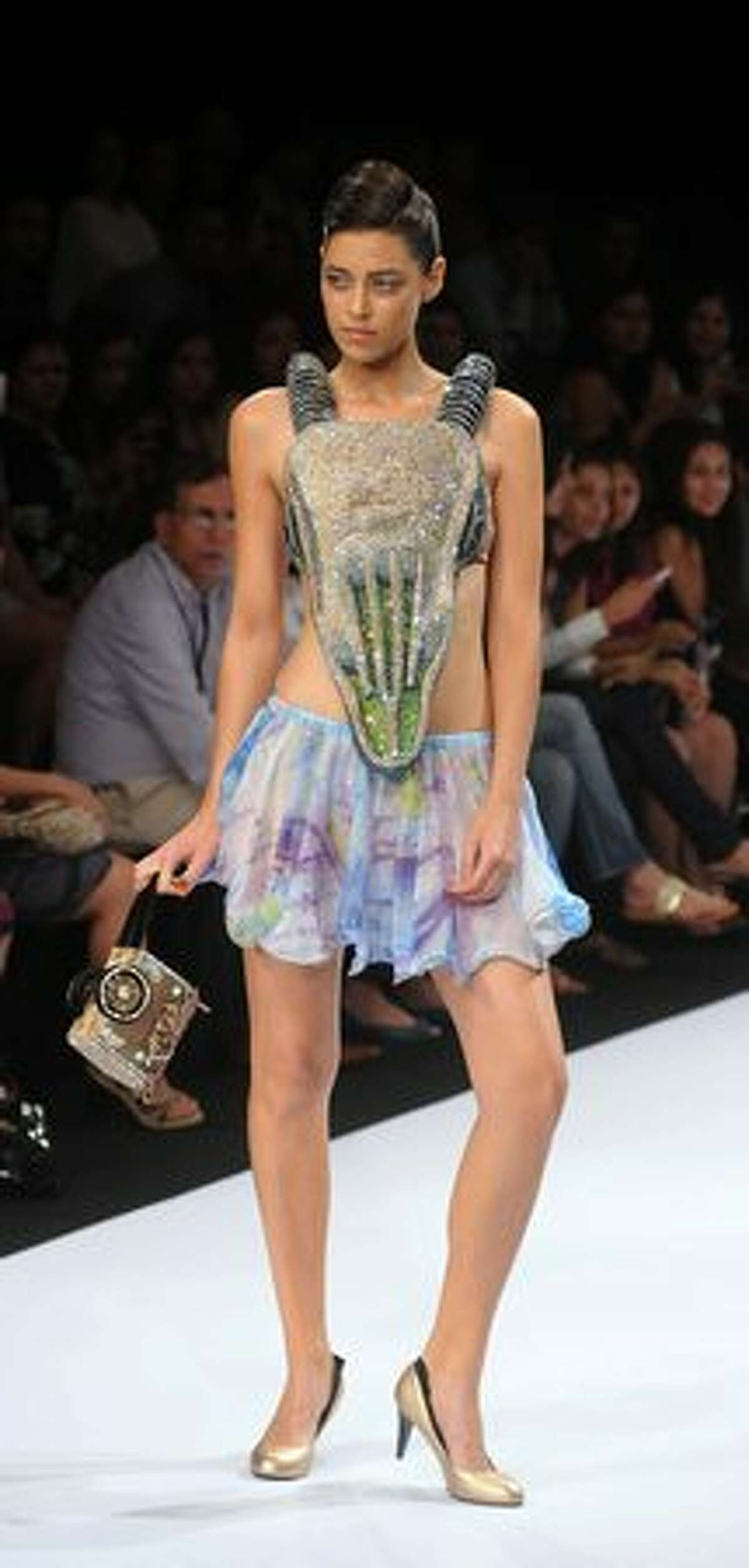 A model displays a creation during the Gennext Designers show at the opening of the Summer Resort 2011 Lakme Fashion Week in Mumbai, India on Friday, March 11, 2011.