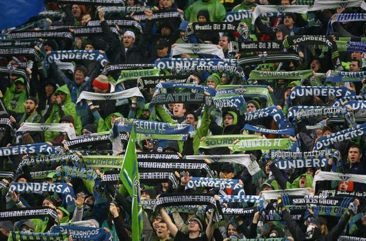 Seattle Sounders fans hold up their scarves during the MLS regular season opener against the L.A. Galaxy on Tuesday, March 15, 2011 at Qwest Field in Seattle.