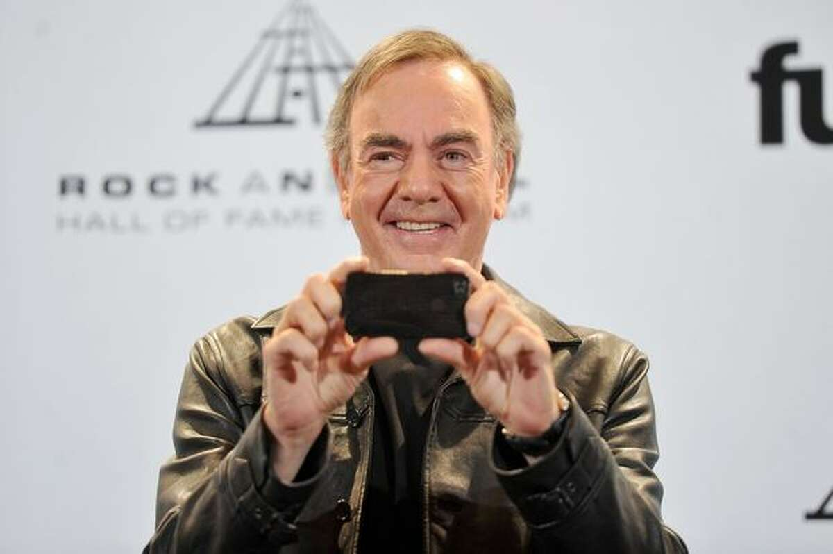 Inductee Neil Diamond poses in the press room at the 26th annual Rock and Roll Hall of Fame Induction Ceremony at The Waldorf-Astoria in New York on Monday, March 14, 2011.