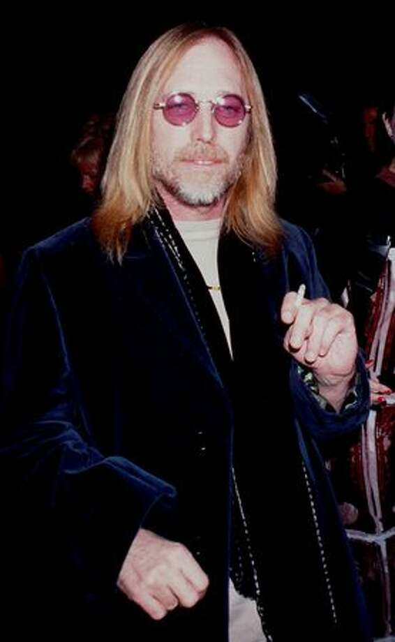 "Tom Petty, pictured at the premiere of ""The Postman."" Photo: Getty Images / Getty Images"
