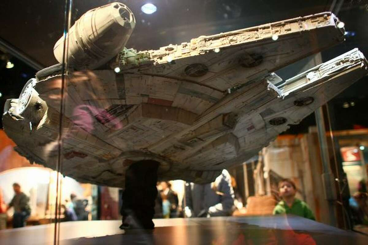 The Millennium Falcon model from Episode IV is shown during a preview of the exhibit