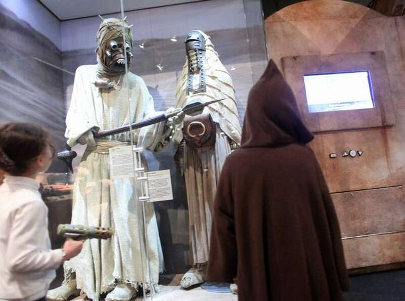 Sand People greet visitors during a preview of the exhibit