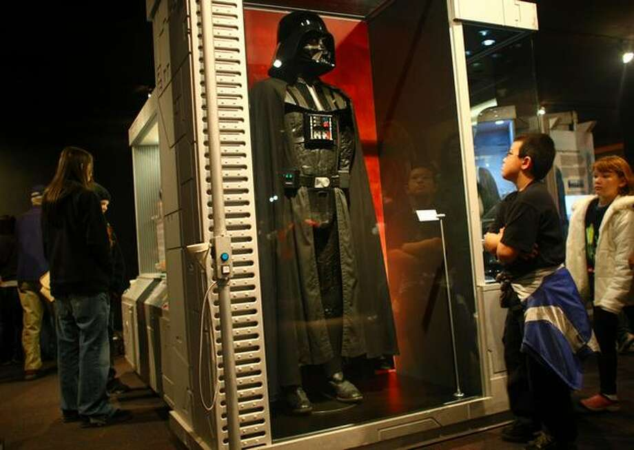 "The Darth Vader costume used in Episodes IV-VI greets visitors during a preview of the exhibit ""Star Wars: Where Science Meets Imagination."" Photo: Joshua Trujillo, Seattlepi.com / seattlepi.com"