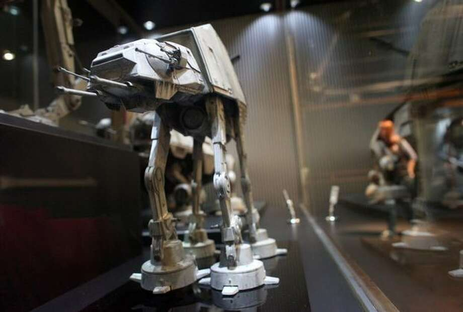 "A model of an AT-AT walker is shown during a preview of the exhibit ""Star Wars: Where Science Meets Imagination."" Photo: Joshua Trujillo, Seattlepi.com / seattlepi.com"