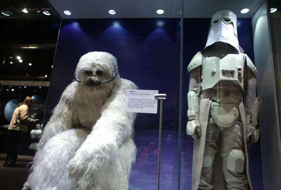 "A Wampa costume from the Empire Strikes Back and an Imperial Snowtrooper are shown during a preview of the exhibit ""Star Wars: Where Science Meets Imagination."" Photo: Joshua Trujillo, Seattlepi.com / seattlepi.com"